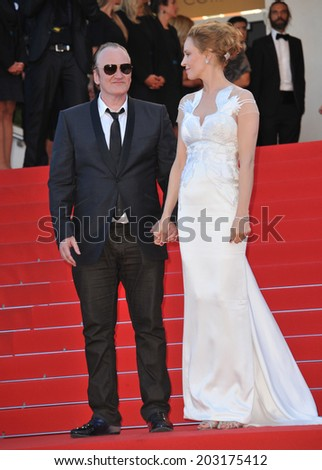 CANNES, FRANCE - MAY 24, 2014: Uma Thurman & Quentin Tarantino at the gala awards ceremony at the 67th Festival de Cannes.  - stock photo