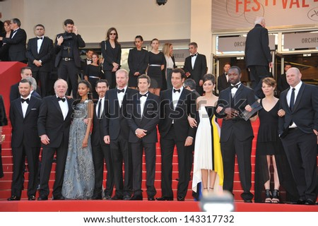 "CANNES, FRANCE - MAY 20, 2013: Zoe Saldana, Marion Cotillard, Billy Crudup, James Caan, Noah Emmerich & director Guillaume Canet at the gala premiere of ""Blood Ties"" at the 66th Festival de Cannes.  - stock photo"