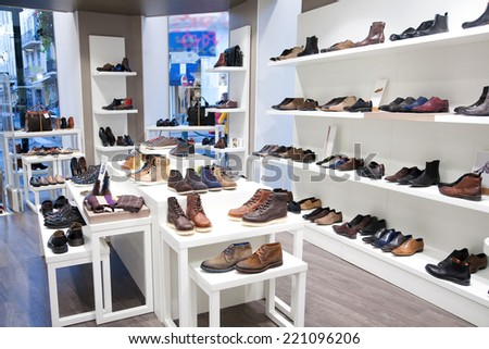 CANNES, FRANCE- OCTOBER 1, 2012: Mens footwear in a clothing store - stock photo