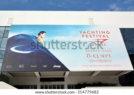 CANNES, FRANCE - SEPTEMBER 09: The poster for the Yachting Festival shown on september, 2015 in Cannes, France.This festival gathers the professionals of world sailing with 550 exposed boats. - stock photo