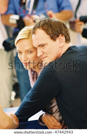 CANNES - MAY 16:  Director Quentin Tarantino and actress Uma Thurman attend a photocall for the movie 'Kill Bill 2' at the 57th Annual Cannes Film Festival on May 16, 2004 in Cannes, France - stock photo