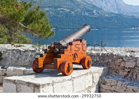 Cannon at old fortress in medieval town Korcula. Croatia, Dalmatia region, Europe. - stock photo
