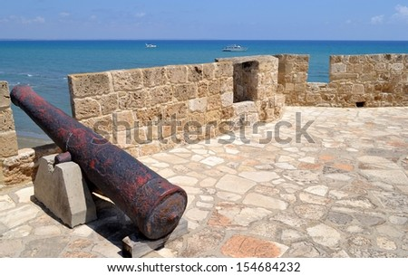 Cannon from castle and sea  - stock photo