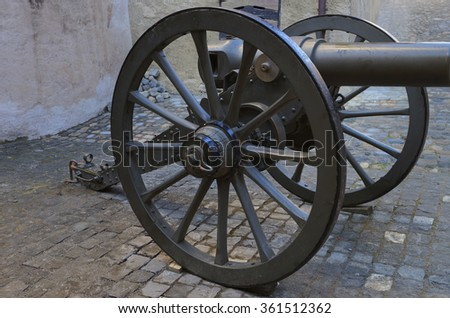 Cannon in the street in Thun Castle. Thun Castle is a Castle Museum in the Thun city, in Swiss canton of Bern, where the Aare river flows out of Lake Thun. Today it is a Switzerland heritage site. - stock photo