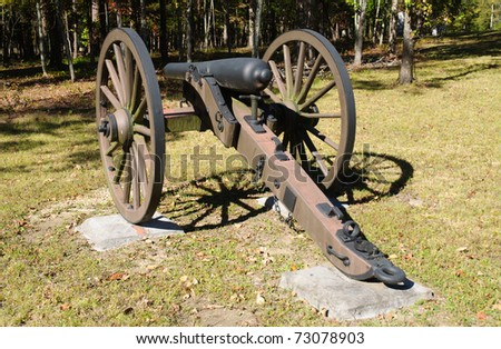 cannon on a battlefield - stock photo
