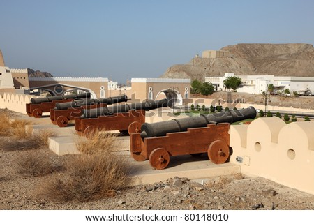 Cannons at the fortified gate to Muttrah, Muscat, Sultanate of Oman - stock photo