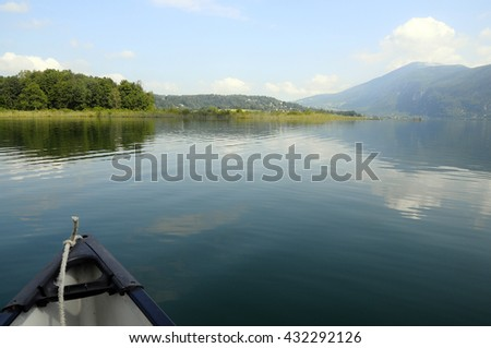 Canoe and landscape on Aiguebelette quiet lake, in Savoy, France - stock photo
