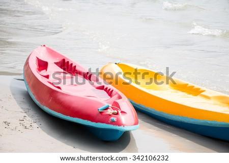 Canoe, kayaks land on the beach at beach of Toey Ngam, Thailand. - stock photo
