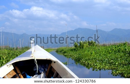 canoe on a river in a gorgeous landscape in the shan state of Myanmar