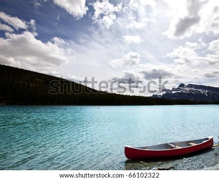 canoe on lake - stock photo