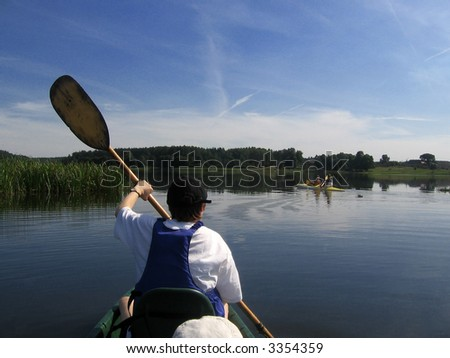canoe on the river,  family on river: mother and daughter - stock photo