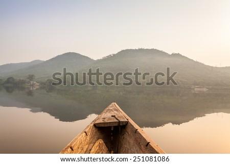 Canoe ride around tropical island in Ghana, Africa - stock photo