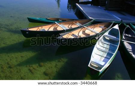 Canoe's ready to rent on Jenny Lake, Grand Teton National Park, Wyoming - stock photo