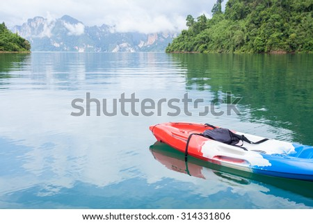 canoe with sky and cloud in water at lake