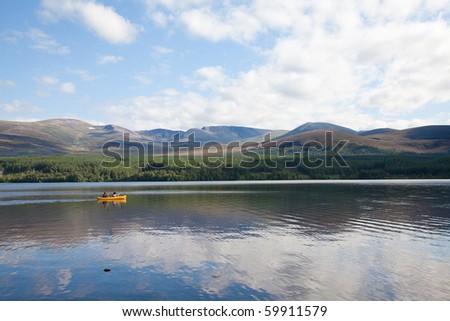 Canoeing on Loch Morlich, Scotland - stock photo