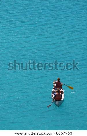 Canoeing on Moraine Lake in Banff National Park - stock photo