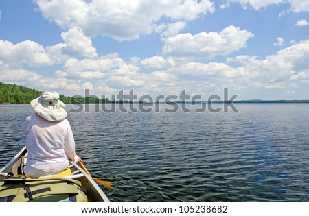 Canoer on Brule Lake in the Boundary Waters - stock photo