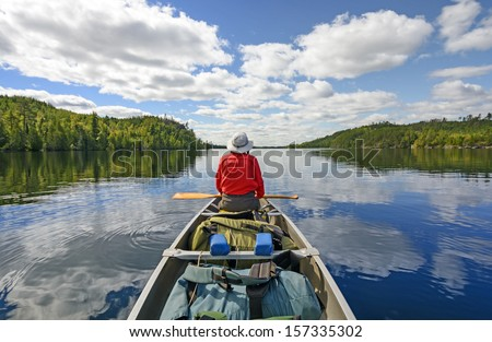 Canoer on Kekekabic Lake in the Boundary Waters in Minnesota - stock photo