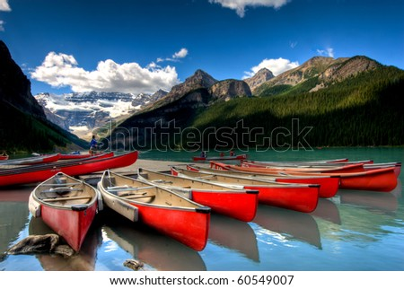 canoes on beautiful tourquoise lake - stock photo