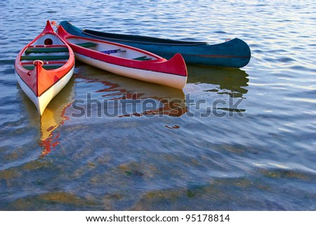 canoes on water - stock photo