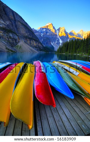 Canoes rest on the dock of Lake Moraine, Banff, Canada - stock photo