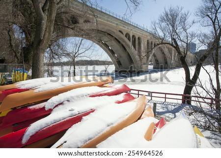 Canoes with Snow Waiting at Key Bridge, Georgetown, Washington, DC - stock photo