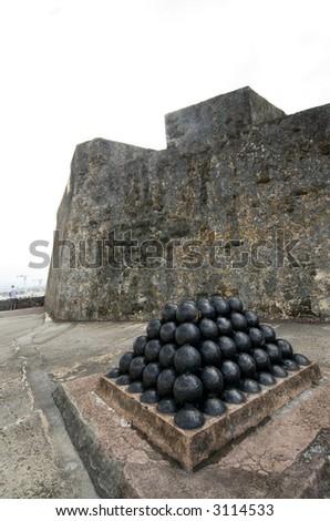 canonballs at el morro old san juan, puerto rico fort - stock photo
