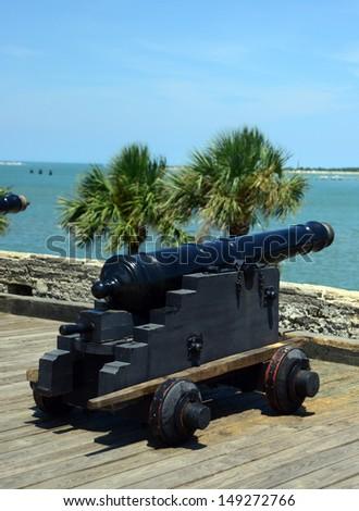 canons pointed toward ocean at Castillo de San Marcos fort - stock photo