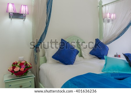 Canopy bed in moroccan luxury hotel - stock photo