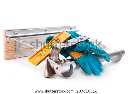 Canopy with aluminum structure, level, claw, screws, gloves, plumb on white background