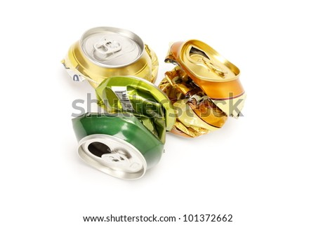 Cans of drinks crumpled on a white background - stock photo