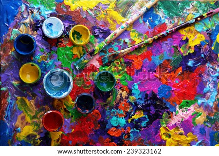 Cans of paint and brush on colorful painted background - stock photo