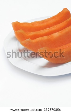 cantaloupe melon slices on white background