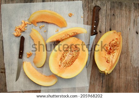 Cantaloupe Sliced cantaloupe on white  paper - stock photo