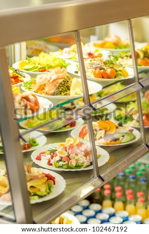 Canteen self-service food display plate with fresh made salad - stock photo