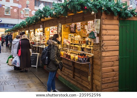 CANTERBURY, ENGLAND - DEC 3, 2014.The Whitefriars Christmas Market with over 35 colourful cabins selling festive produce, gifts and decorations. - stock photo
