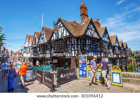CANTERBURY, ENGLAND - JULY 10, 2015: street view with unidentified people of the old town of Canterbury, Kent, England. Canterbury is a historic English cathedral city  - stock photo