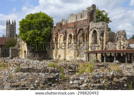 CANTERBURY, UK - JULY 19TH 2015: The historic remains of St. Augustines Abbey in Canterbury, Kent on 19th July 2015.  The tower of Canterbury Cathedral can be seen in the background. - stock photo