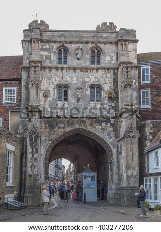 CANTERBURY, UK - SEPTEMBER 11, 2012: Tourists queueing under the Saint Augustine Gate in order to visit Canterbury Cathedral - stock photo