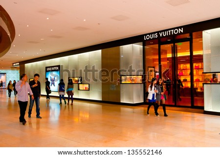 CANTON,CHINA - APR 13: Louis Vuitton shop on Apr 13, 2013 in Canton. Forbes claims Louis Vuitton was the most powerful luxury brand in the world in 2008 with $19.4bn USD value. LV was founded in 1854 - stock photo