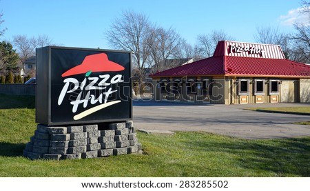 CANTON, MI - DECEMBER 29:  Pizza Hut, whose Canton location is shown on December 29, 2014, has more than 11,000 stores worldwide. - stock photo