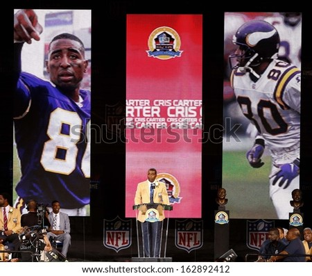 CANTON, OH-AUG 3: Former Minnesota Vikings receiver Cris Carter gives his speech during the NFL Class of 2013 Enshrinement Ceremony at Fawcett Stadium on August 3, 2013 in Canton, Ohio. - stock photo