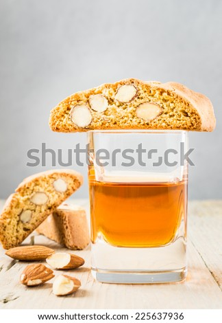 Cantuccini biscuits and dessert wine on rustic wood background, typical tuscan cookies. - stock photo