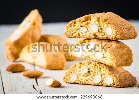 Cantuccini on white wood background, typical tuscan biscuits. - stock photo
