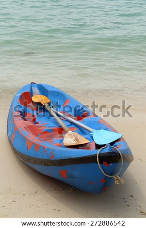 Canue or kayak on the beach. - stock photo