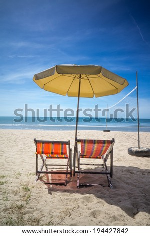 canvas bed on the beach with volleyball net