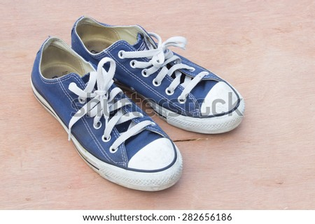 canvas  blue shoes on the wood background