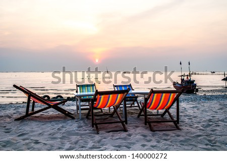 canvas chair on the beach During Sunset