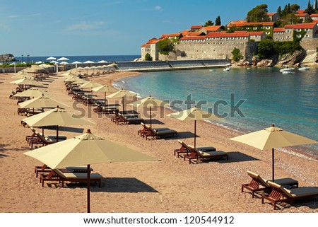 Canvas chairs on the beach - stock photo