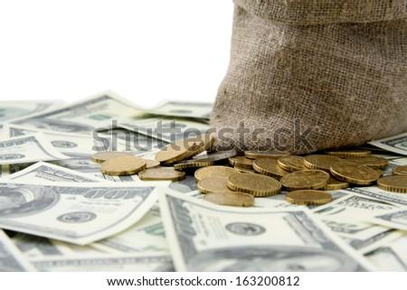 Canvas money sack with  dollar bills, isolated on white background - stock photo